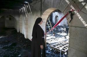Il volto del Sionismo è fotografato nella chiesa bruciata al lago  di Tiberiade
